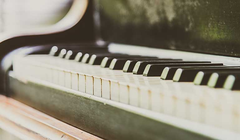 Close up view of keys on a vintage piano
