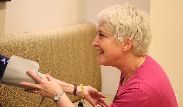 Cedar Springs PARC Wellness Nurse Cathy with a resident