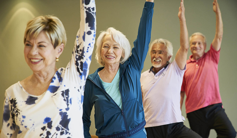 Residents participating in a yoga class