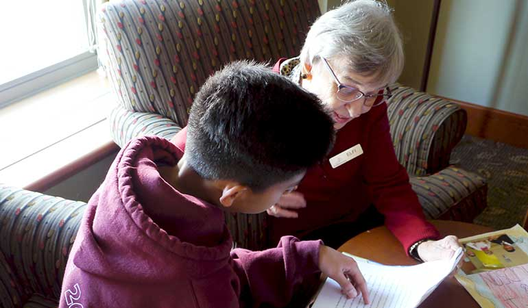 St. Edmunds Student Reading with Resident