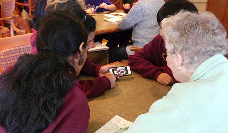 St. Edmunds School Students showing residents iPhone