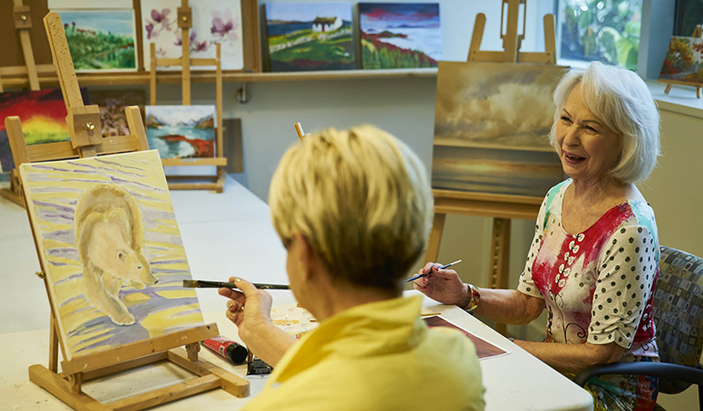 Residents painting in the art studio