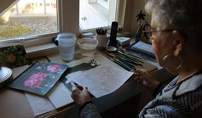 Cedar Springs PARC resident Cathy holding a sketch