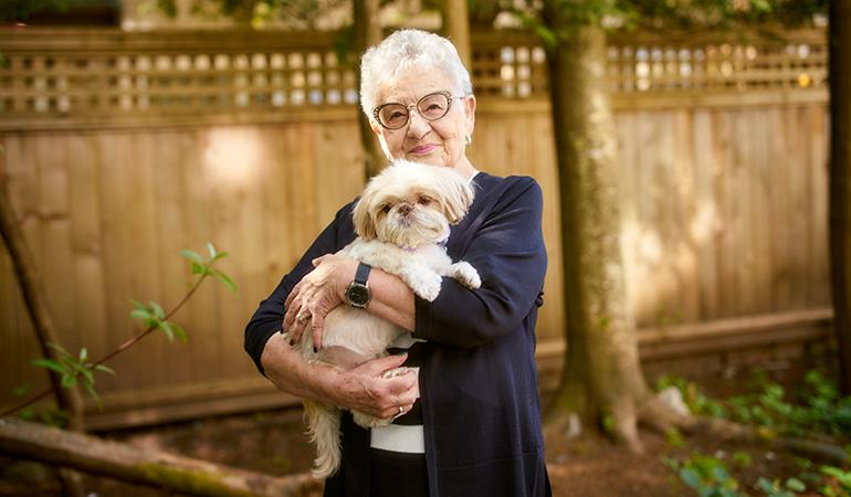 cedar Springs PARC resident Cathy holding her dog Daisy Mae
