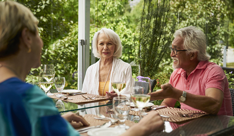 Residents enjoying a meal together on patio