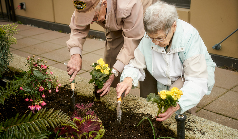 Mulberry PARC residents Bob and Virginia planting flowers