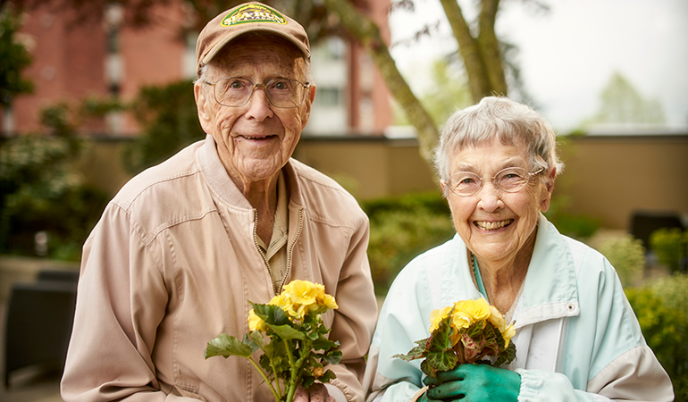 Mulberry PARC residents Bob and Virginia holding flower pots