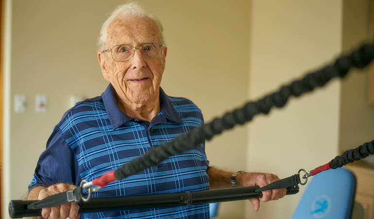 Mulberry PARC resident Bob working out in the gym