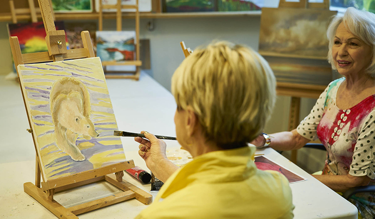 Residents in a painting class