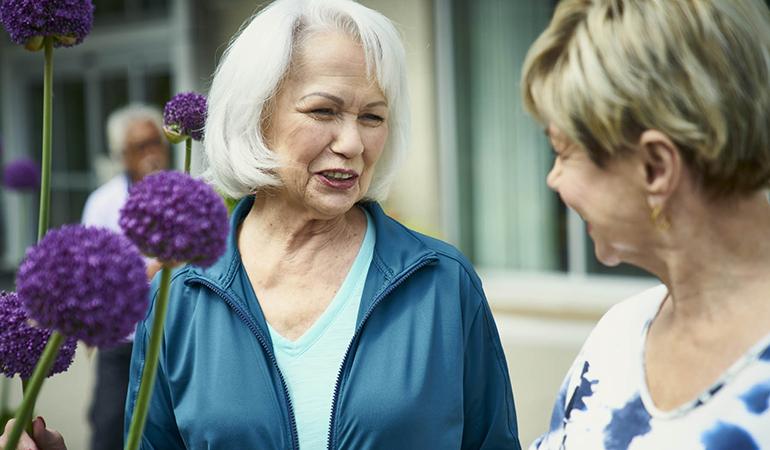 Residents talking in the garden