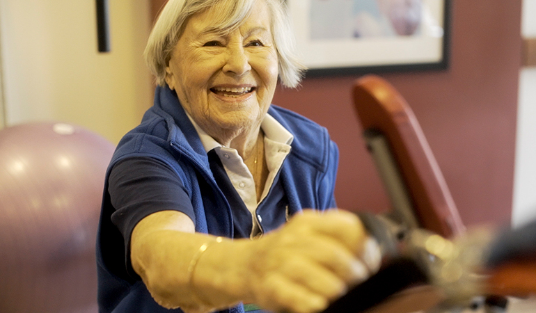 Summerhill PARC Resident Gerta working out in gym