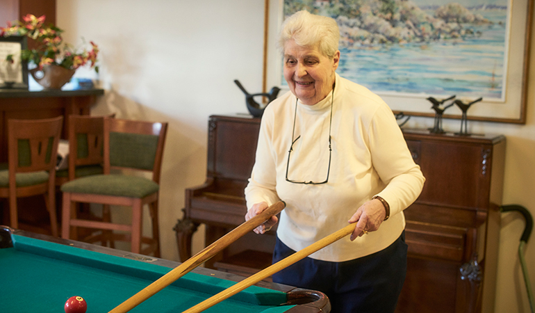 Summerhill PARC resident Peggy at the pool table