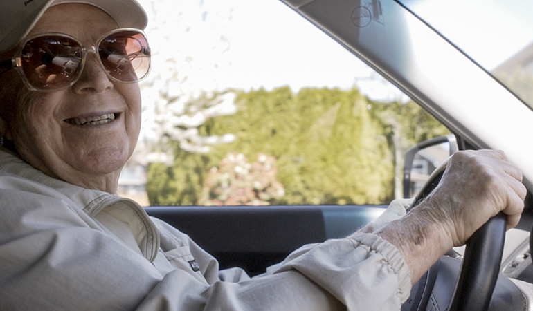 Summerhill PARC resident Rusty behind the wheel of his car