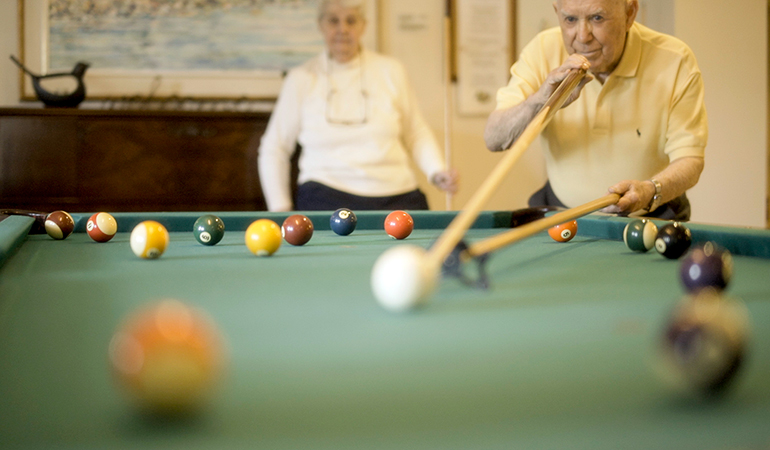 Summerhill PARC resident Rusty taking a shot at the pool table