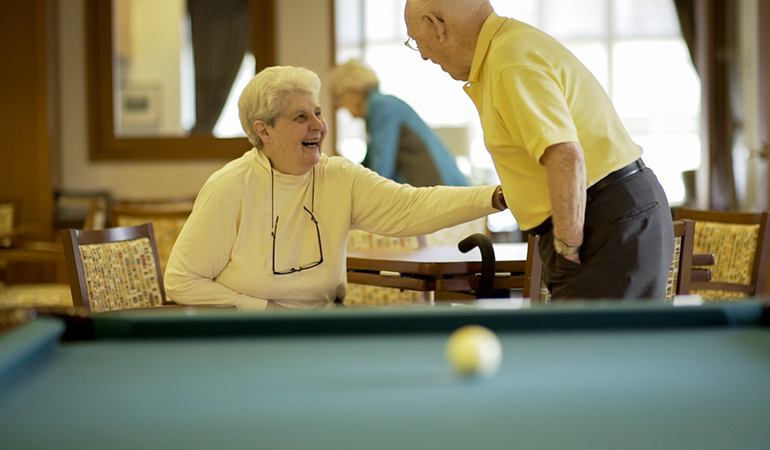 Summerhill PARC residents Peggy and Rusty laughing by the pool table