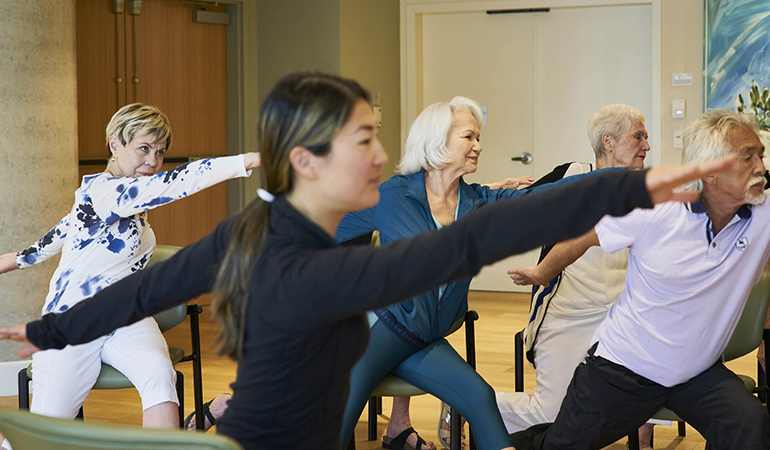Westerleigh PARC resident Bette in yoga class