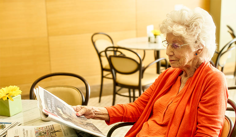Westerleigh PARC resident Dorothy reading the paper