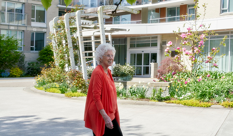 Westerleigh PARC resident Dorothy walking outside