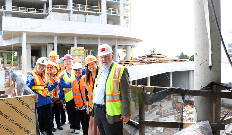 Rainer taking the sales team on a tour of Oceana PARC's construction site