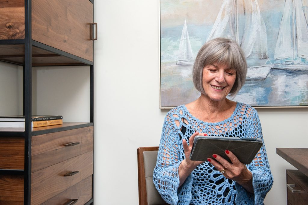 Senior Woman Smiling and Reading in her Room