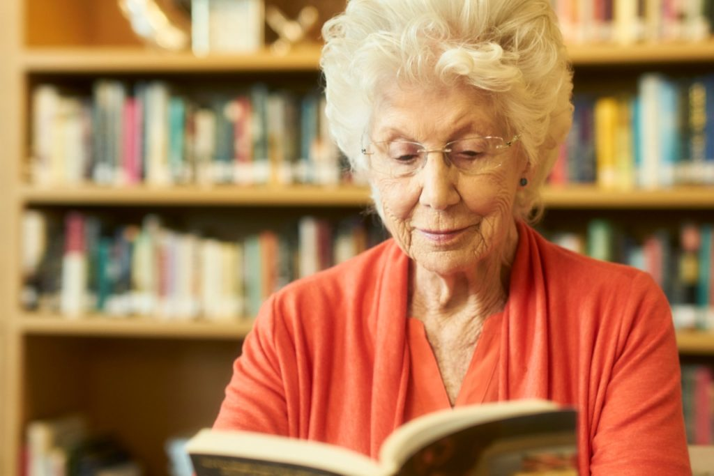 Resident Dorothy Reading Books in the Library