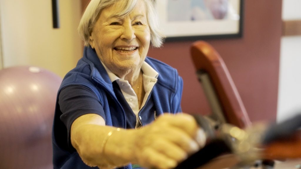 Resident Gerda exercising in the PARC gym