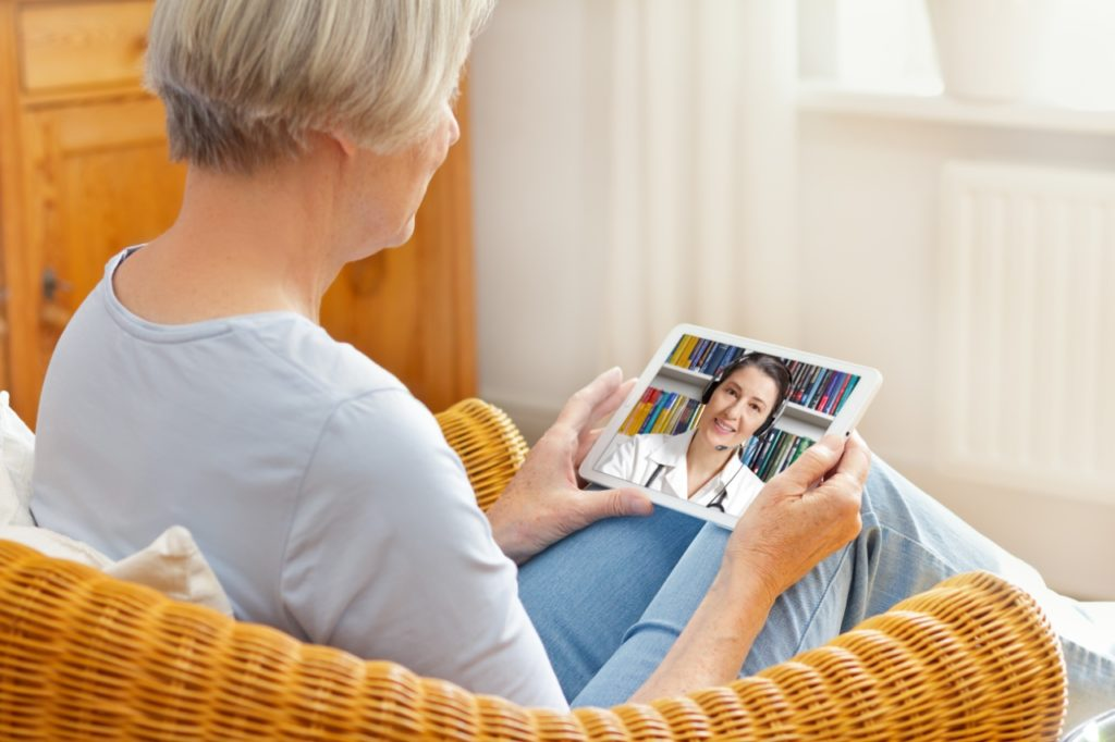 Senior face-timing doctor for help