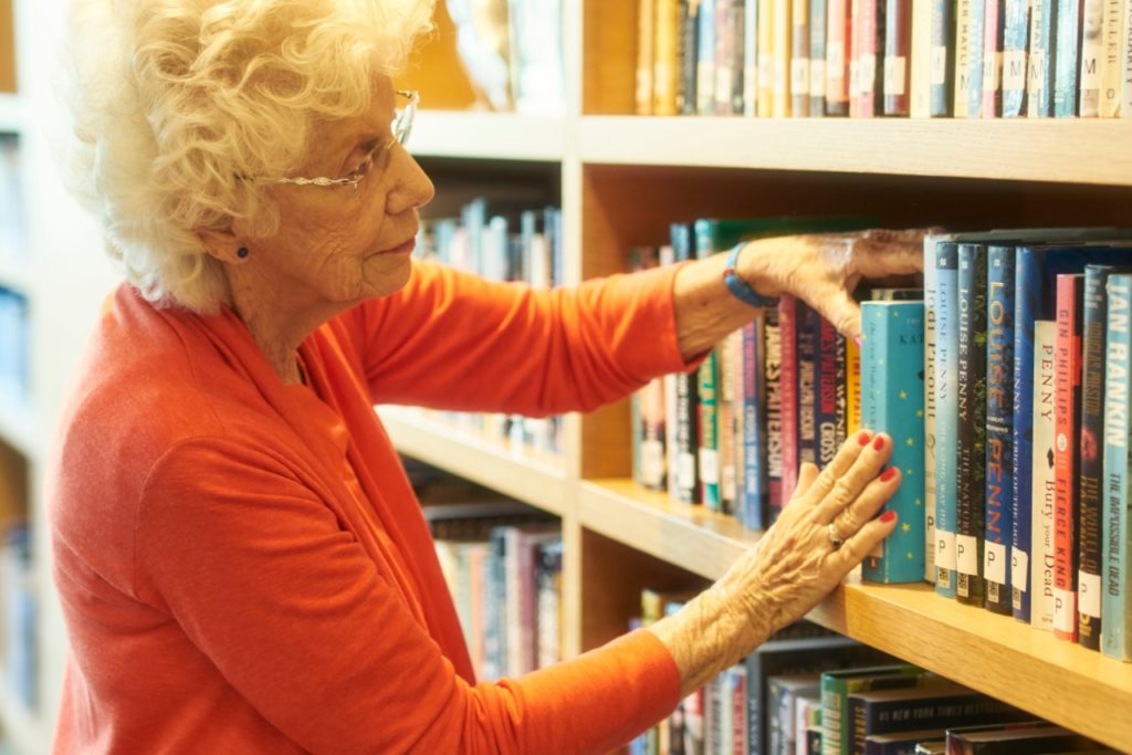 Westerleigh PARC resident reading in the library