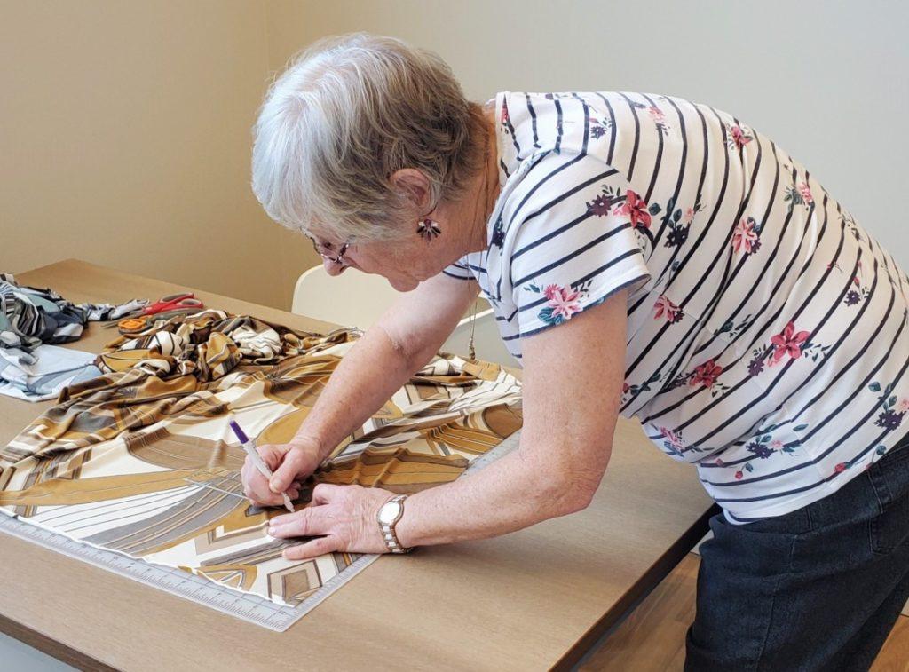 Oceana PARC resident making ear savers headband