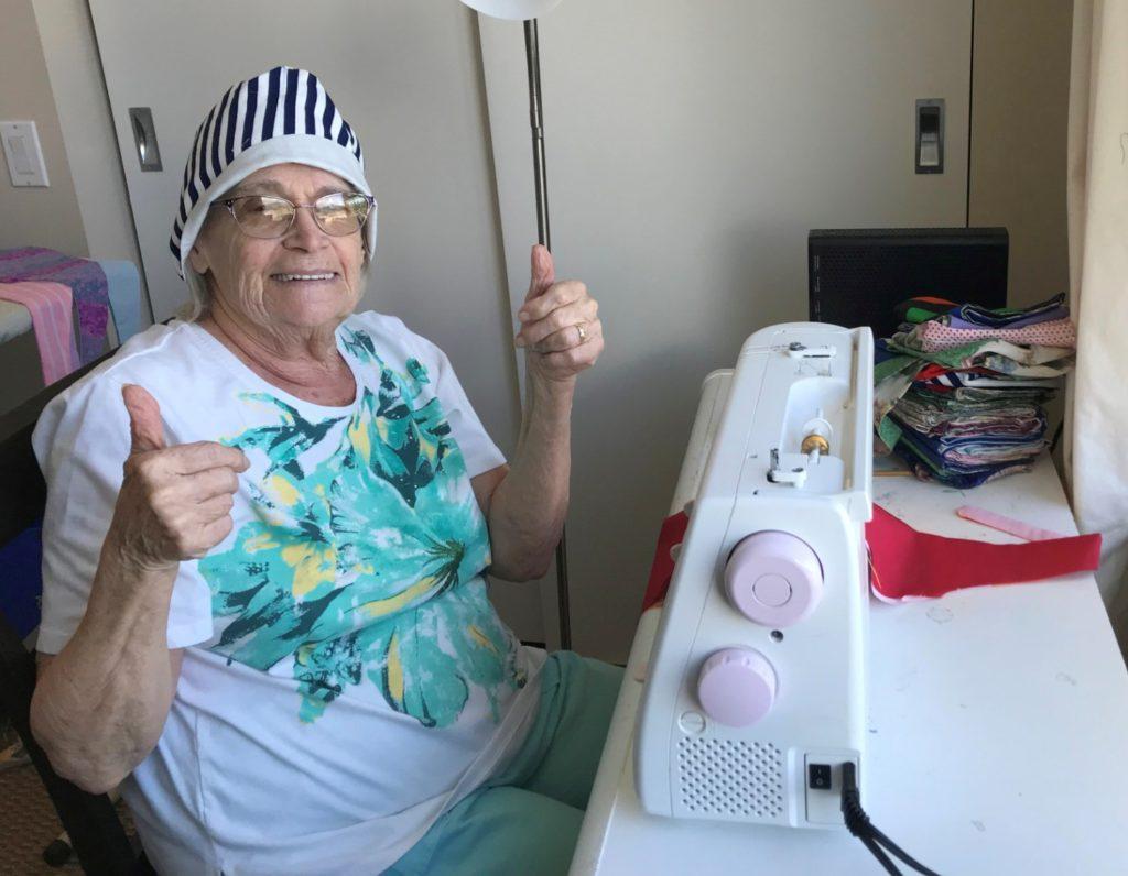 Summerhill PARC resident Pat sewing scrub caps