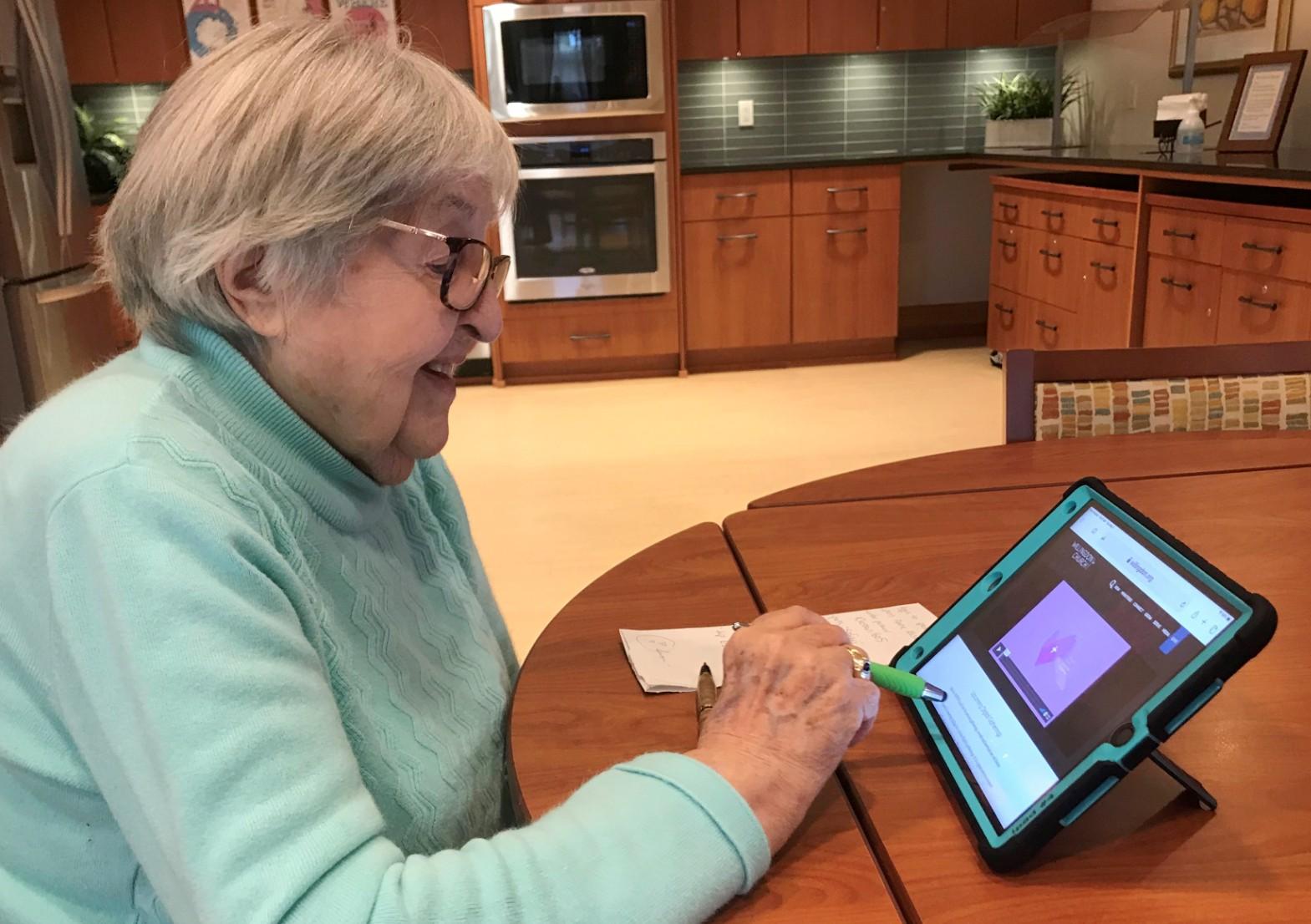 Summerhill PARC resident using tablet