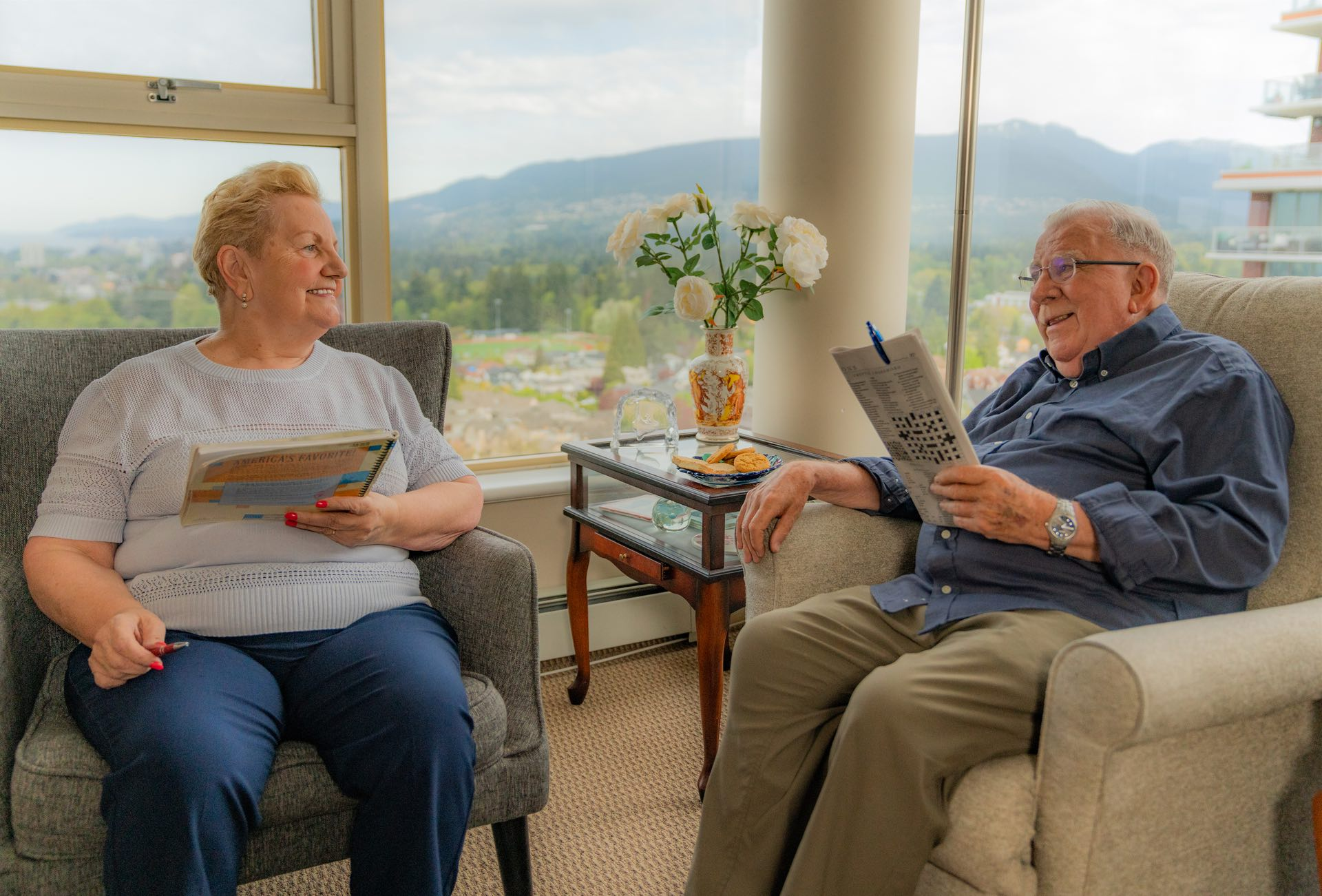 Summerhill PARC residents Marlene and Harry chatting in their suite