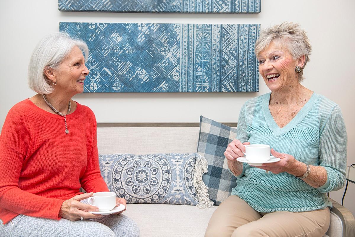Residents enjoying coffee in suite