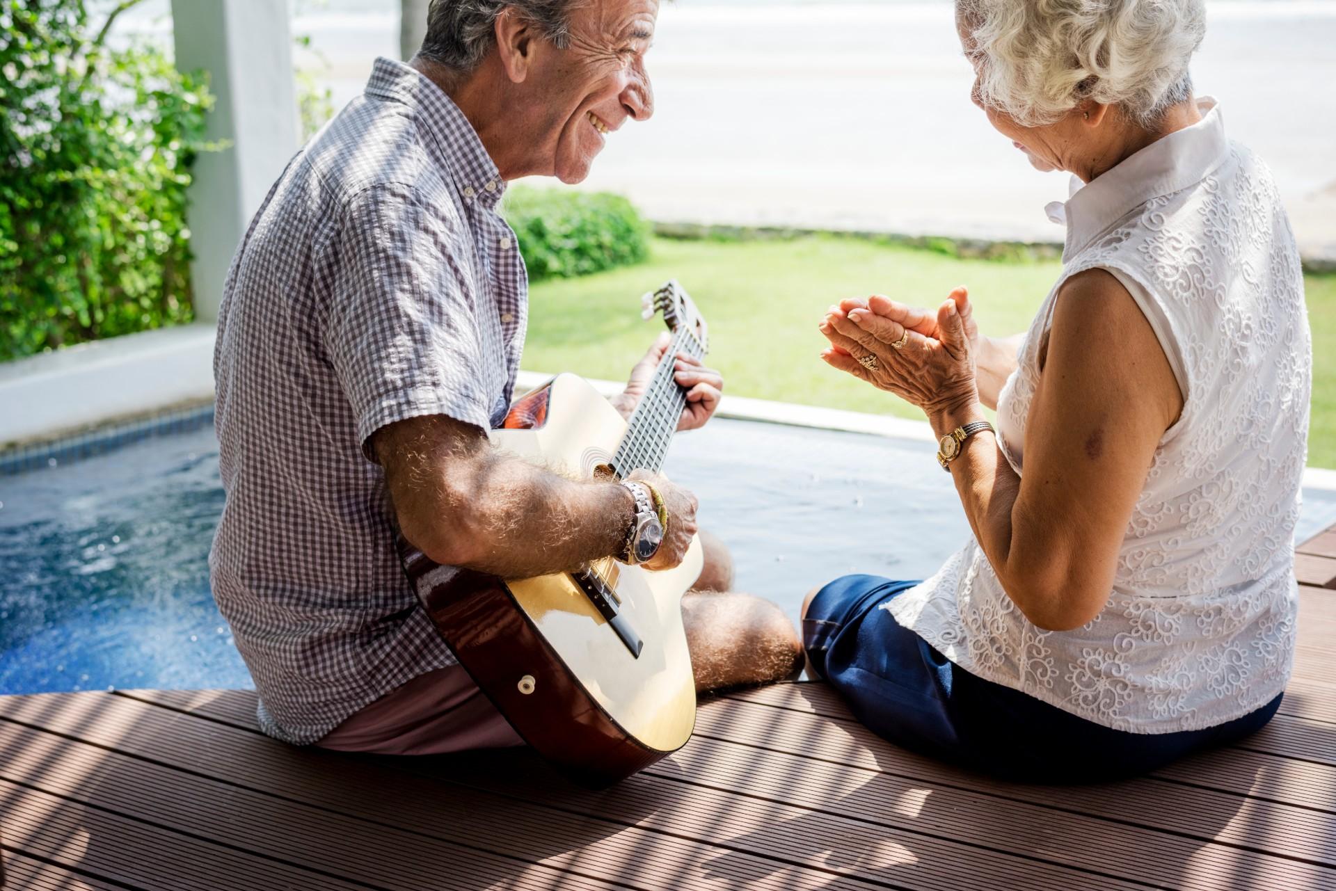 Senior couple smiling on the porch