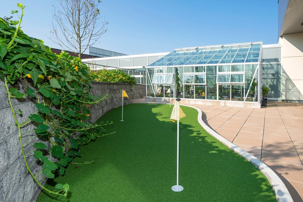 Oceana PARC putting green and greenhouse