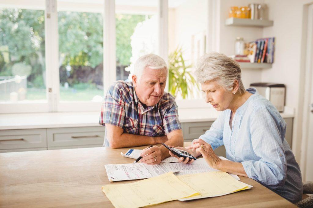 Senior couple calculating costs