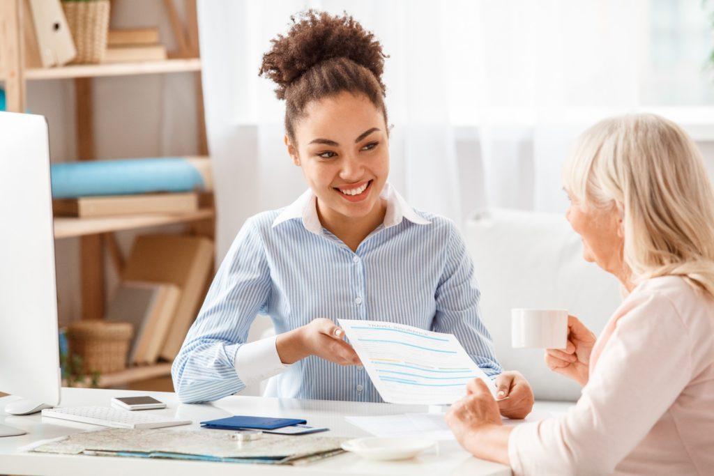 Sales Manager talking to senior woman