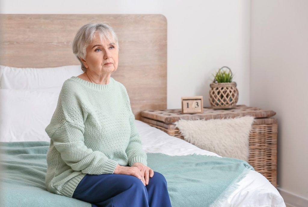 Senior woman lonely in bedroom