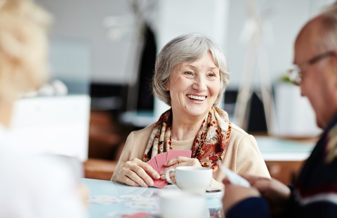 Senior woman chatting with friends