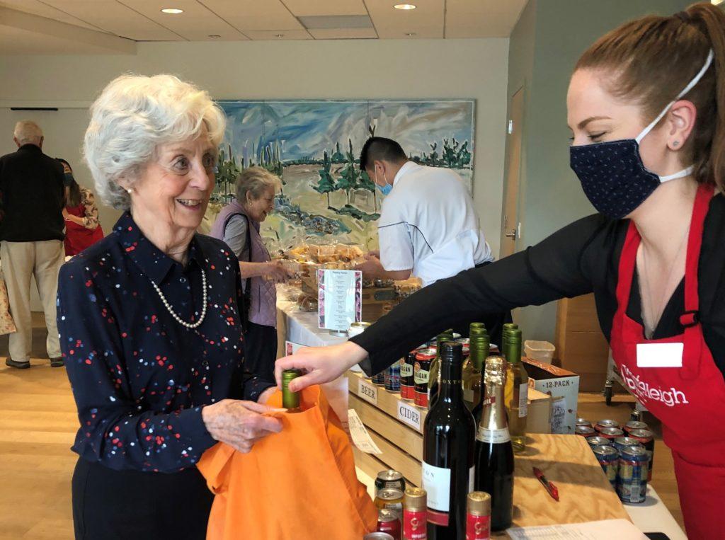 Westerleigh PARC employee masked serving senior resident